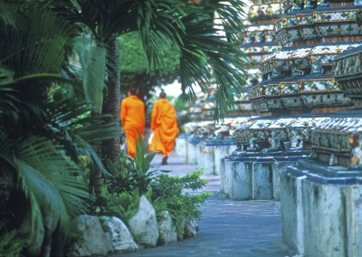 Two monks walking in the Emerald Palace